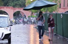 Keeping People Dry With Giant Umbrella