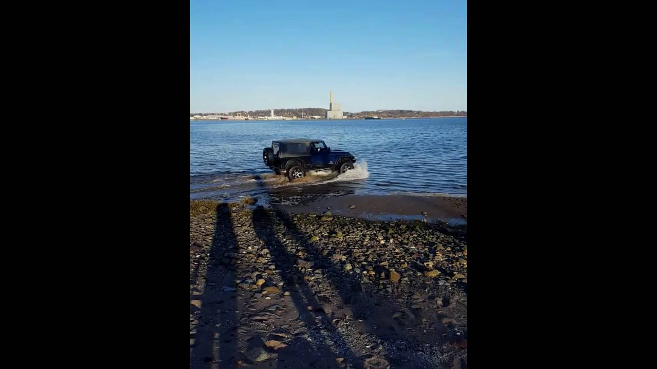 Stupid Driver Gets His Jeep Stuck In The Mud At The Beach