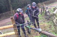 blokes-trying-to-free-a-bike-from-an-electric-fence