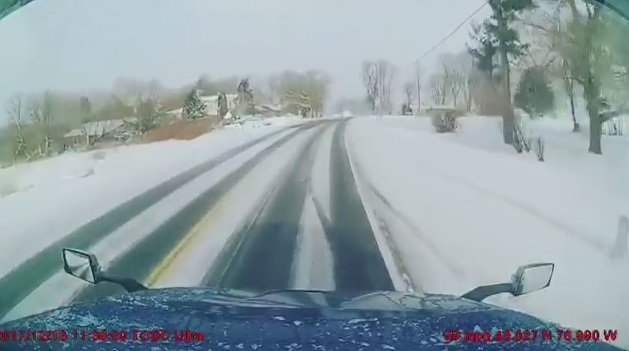 Semi Truck Loses Control on Icy Road