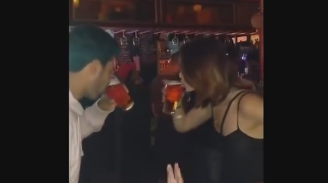 Guy Challenges a Cutie at the Bar to a Beer Chug