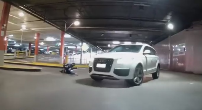 Cyclist Riding Through a Carpark Gets Collected by an SUV and does a Flip