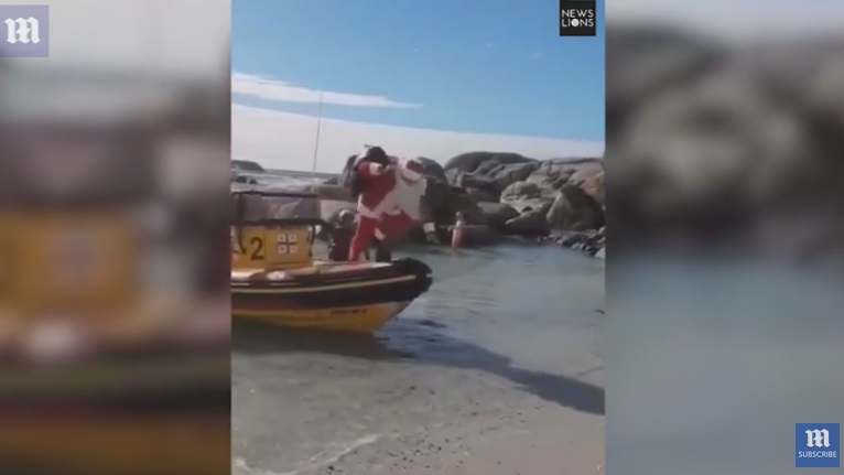 Santa Falls Out of a Boat Whilst Trying to Get Out!