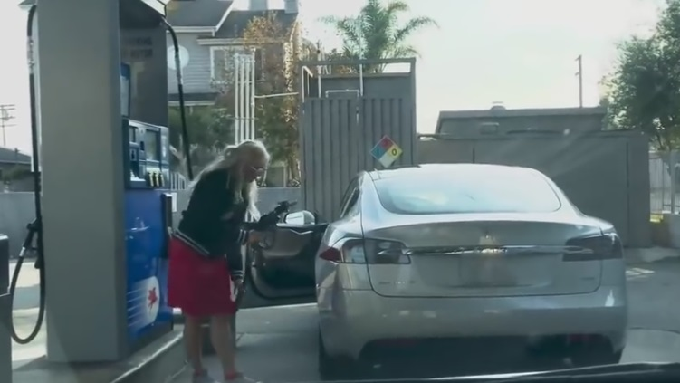 Woman Attempts To Put Gas In Her TESLA?!