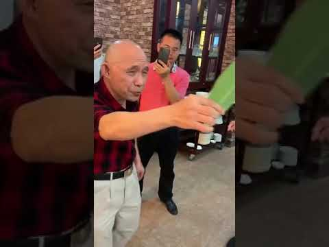 A Chinese Old Man Chopped Wooden Chopsticks With a Leaf
