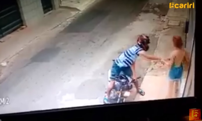 Biker Tries Robbing Tiny Woman, Gets More Than He Bargained For