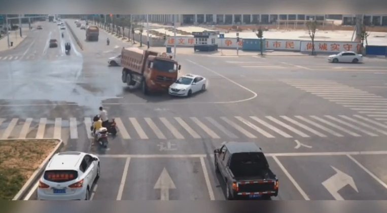 Car Narrowly Avoids Being Crushed by Truck That Flipped Over On Chinese Road