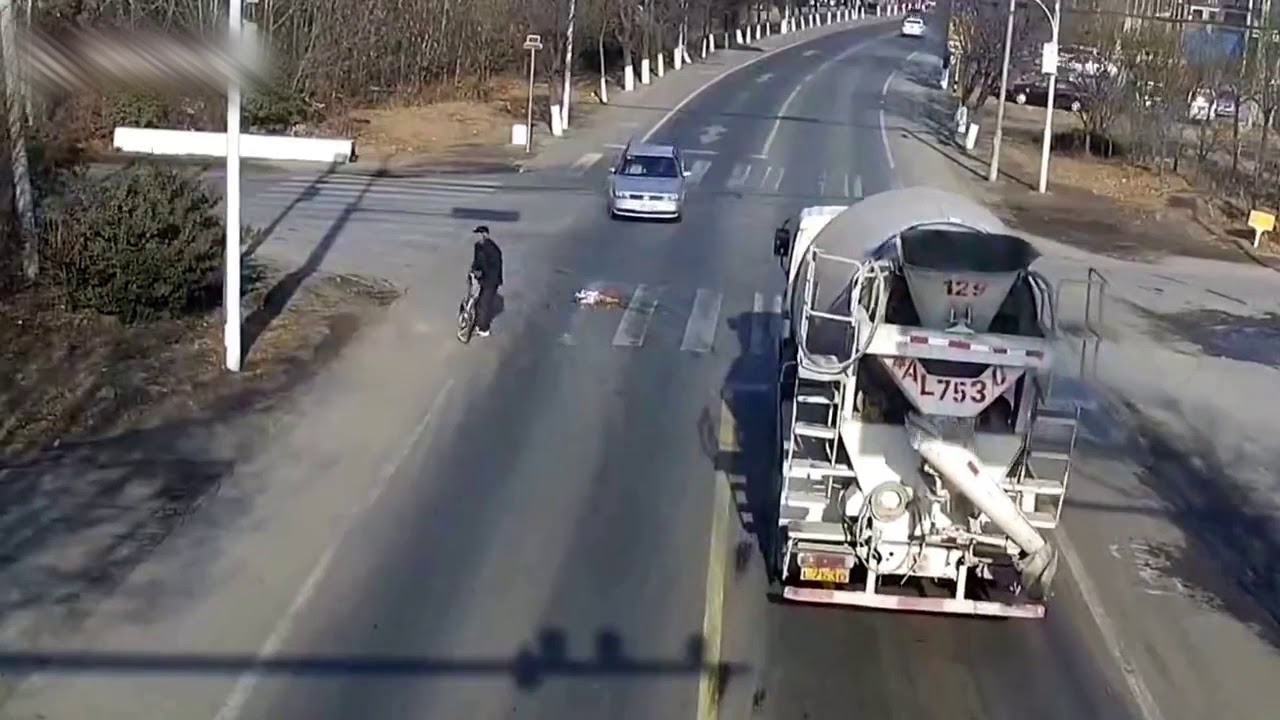Cyclist Gets Run Over By 18-Wheeler, Survives