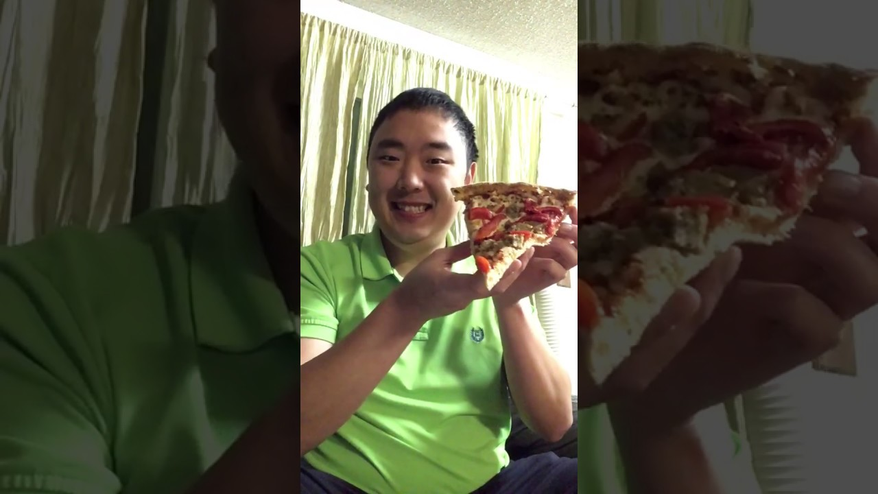 Guy Eats Entire Slice Of Pizza In One Bite!