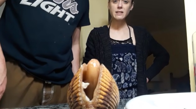 Woman Gets Intrigued At Moving Clam!